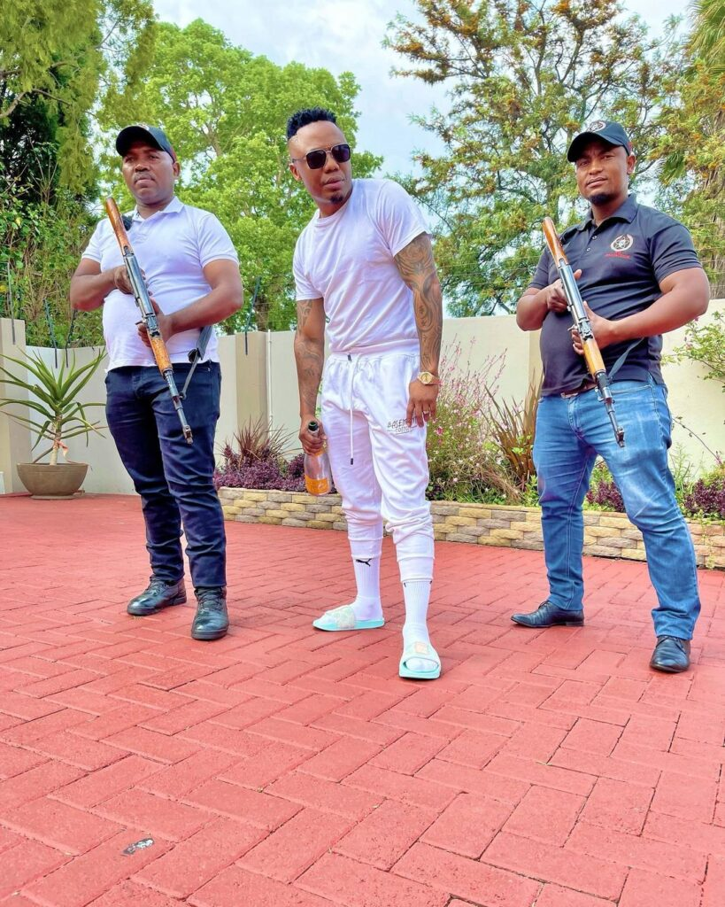Image of DJ Tira and his bodyguards